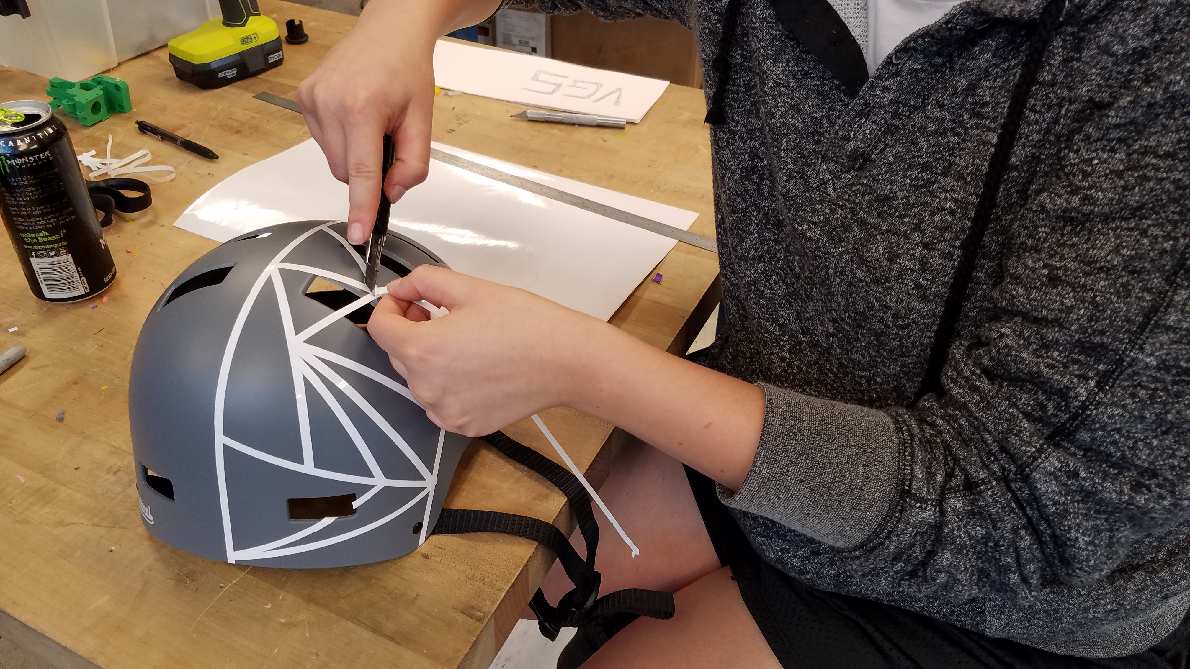 Picture of Apply Vinyl Strips to Half of the Helmet, Making Random Triangles.