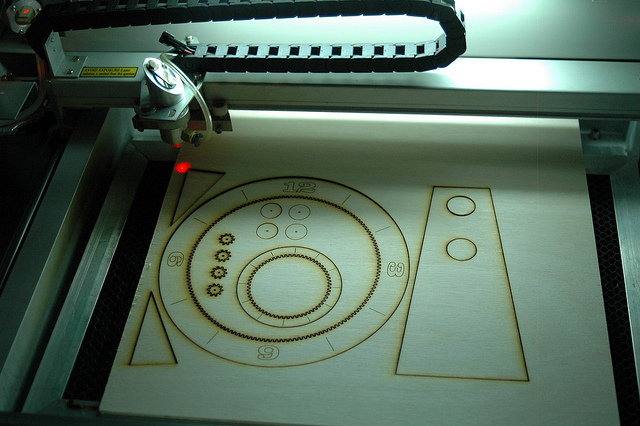 Picture of Cutting the Clock File on the Laser
