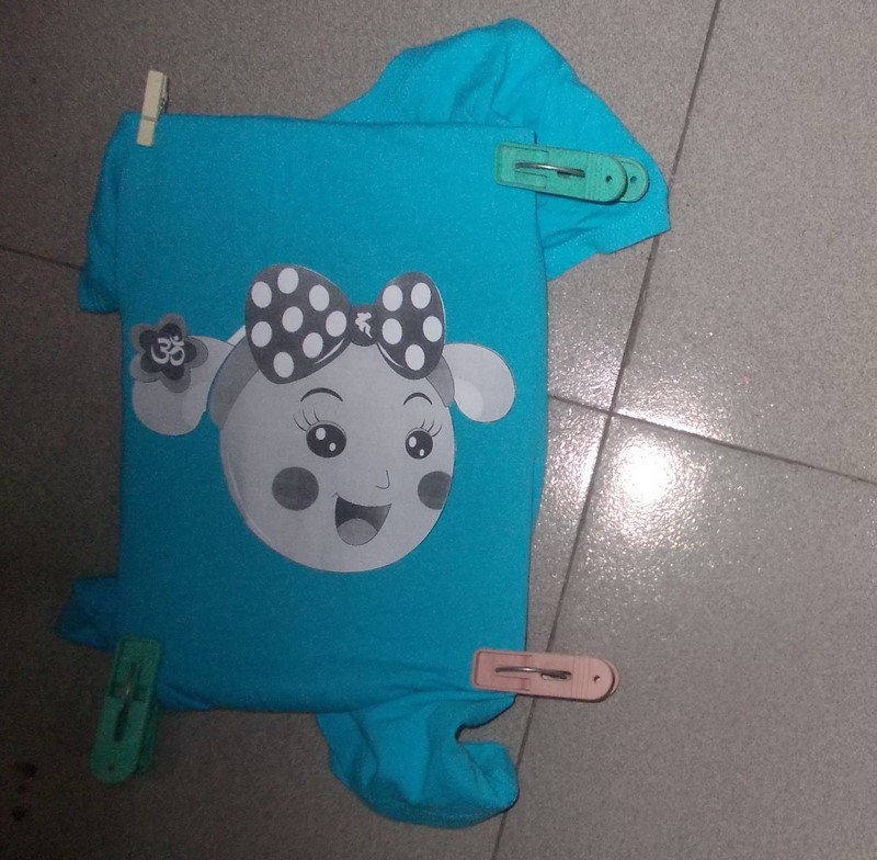 Picture of Cut Out the Template and Draw It on the Shirt Using Transfer Paper.