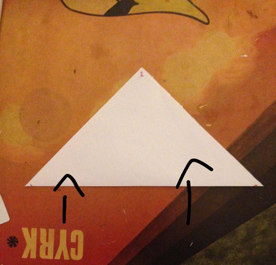 Picture of Fold the Bottom Corner Upwards So That the Number 1 and 3 Are Touching and a Triangle Is Created.