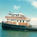 Convert a Wooden tugboat to liveaboard