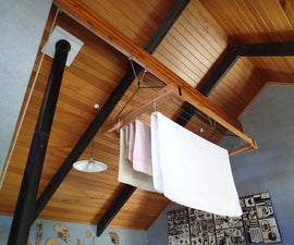 Pulley-controlled clothes drying rack