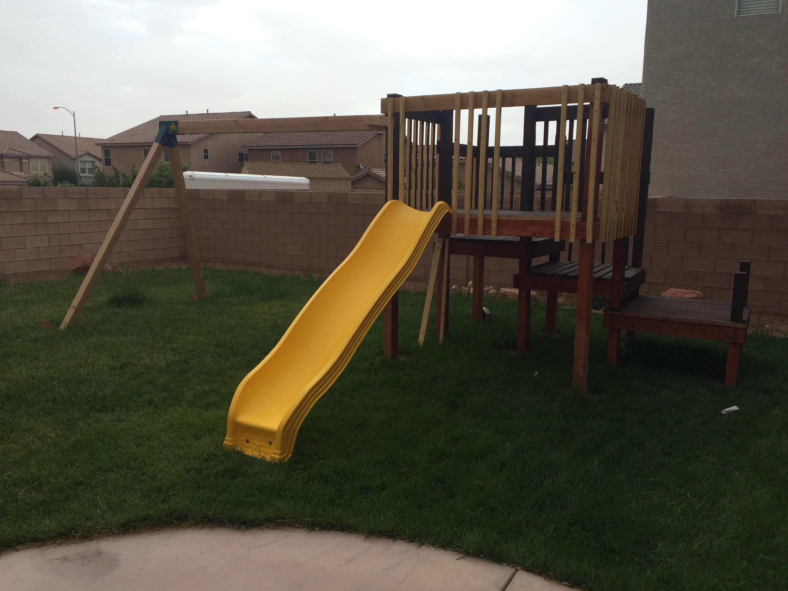 Picture of Fitting the Slide and Attaching the Swing Set
