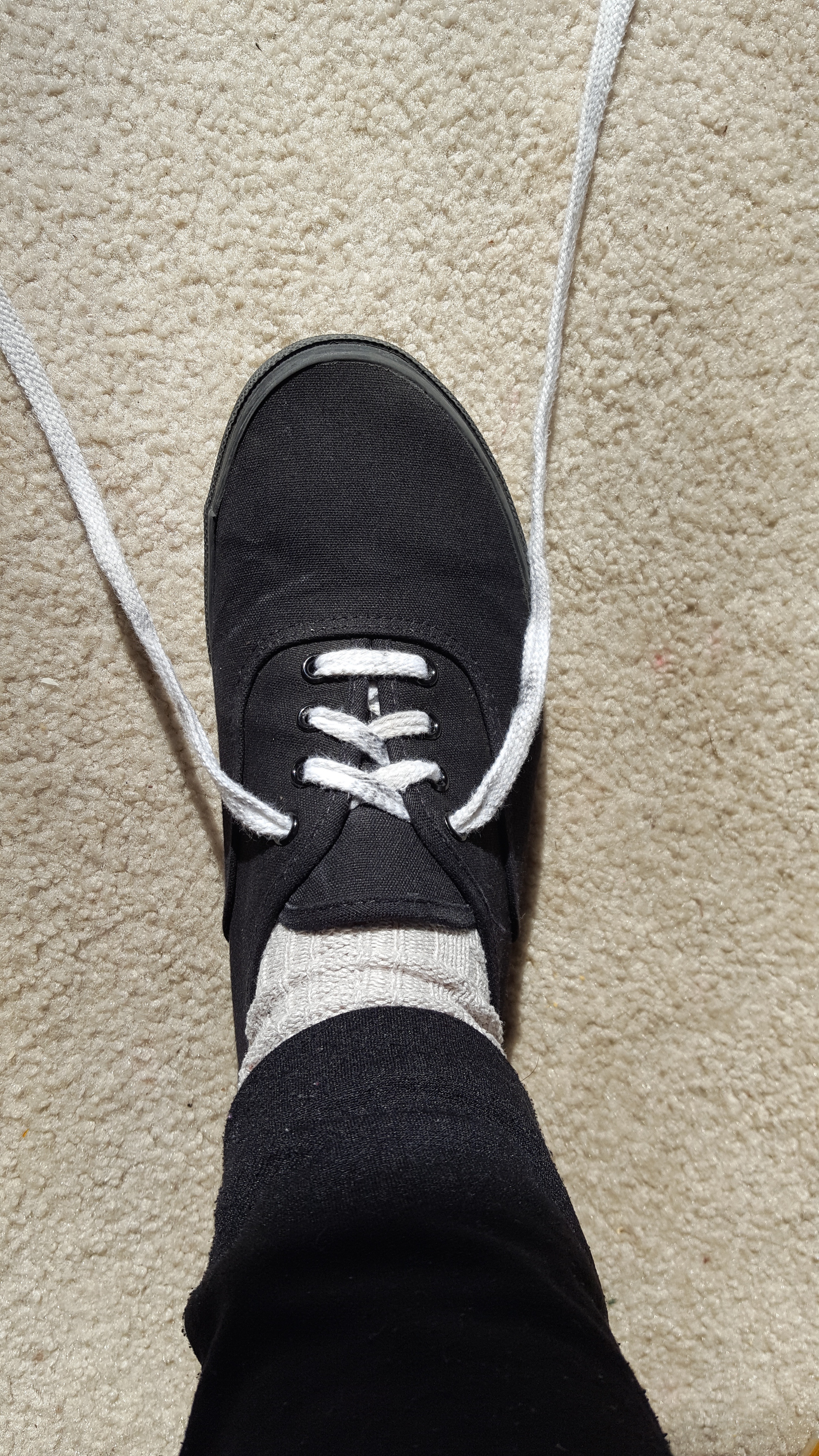 Picture of Start With the Laces Straight on Either Side of the Shoe.