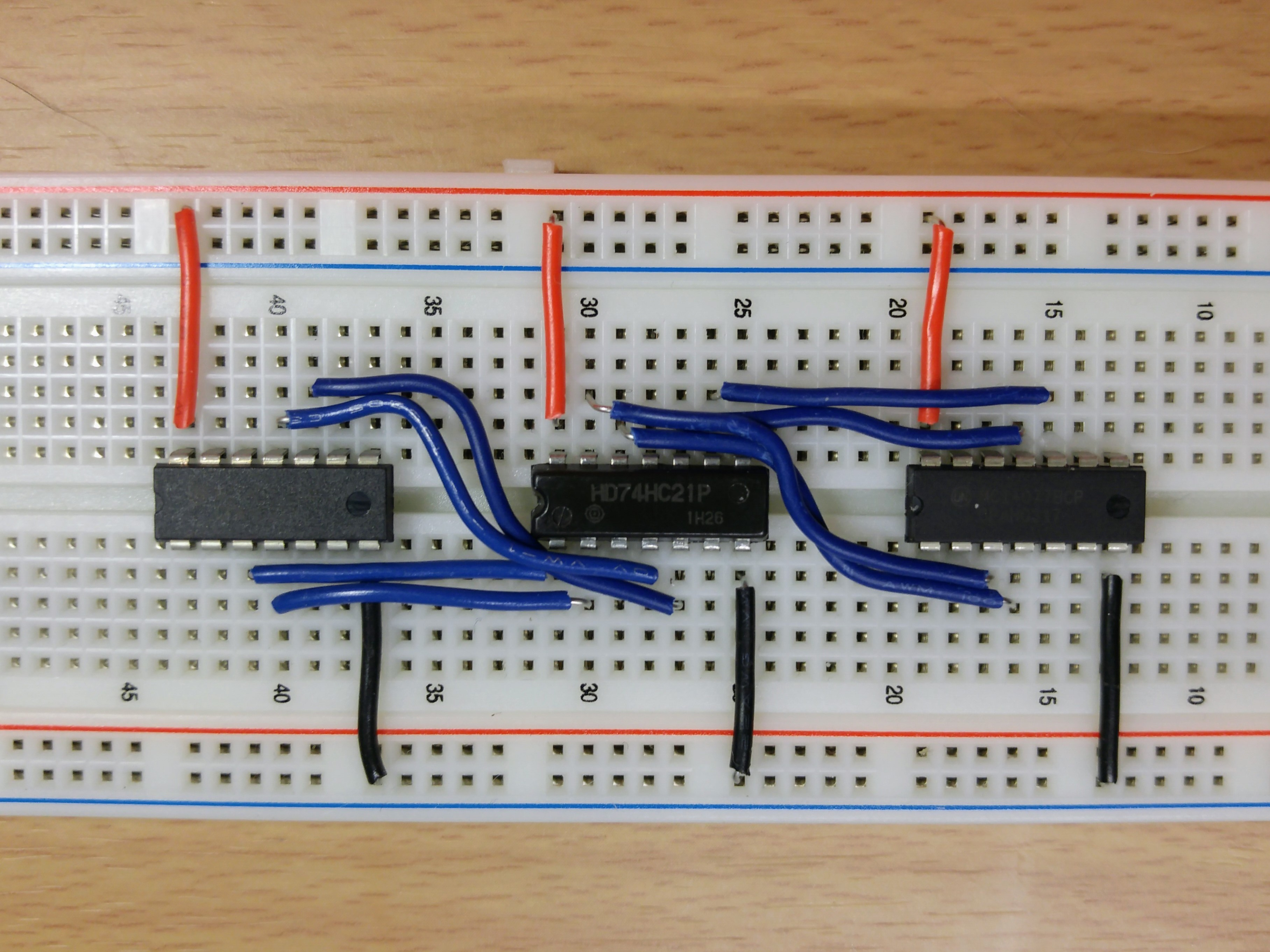 Picture of Connecting the Quad 2-input XNOR Chip to the Dual 4-input AND Chip