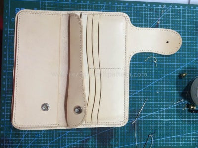 Install 201 Snap(stud and Eyelet) on Pouch Front Leather and Then Sew It With Pouch Back Leather.
