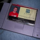 Super Nintendo cartridge wallet with sound, light, and key storage