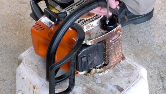 Making the Chainsaw Modification to Use the Air Compressor to Get the Oil Flowing Again