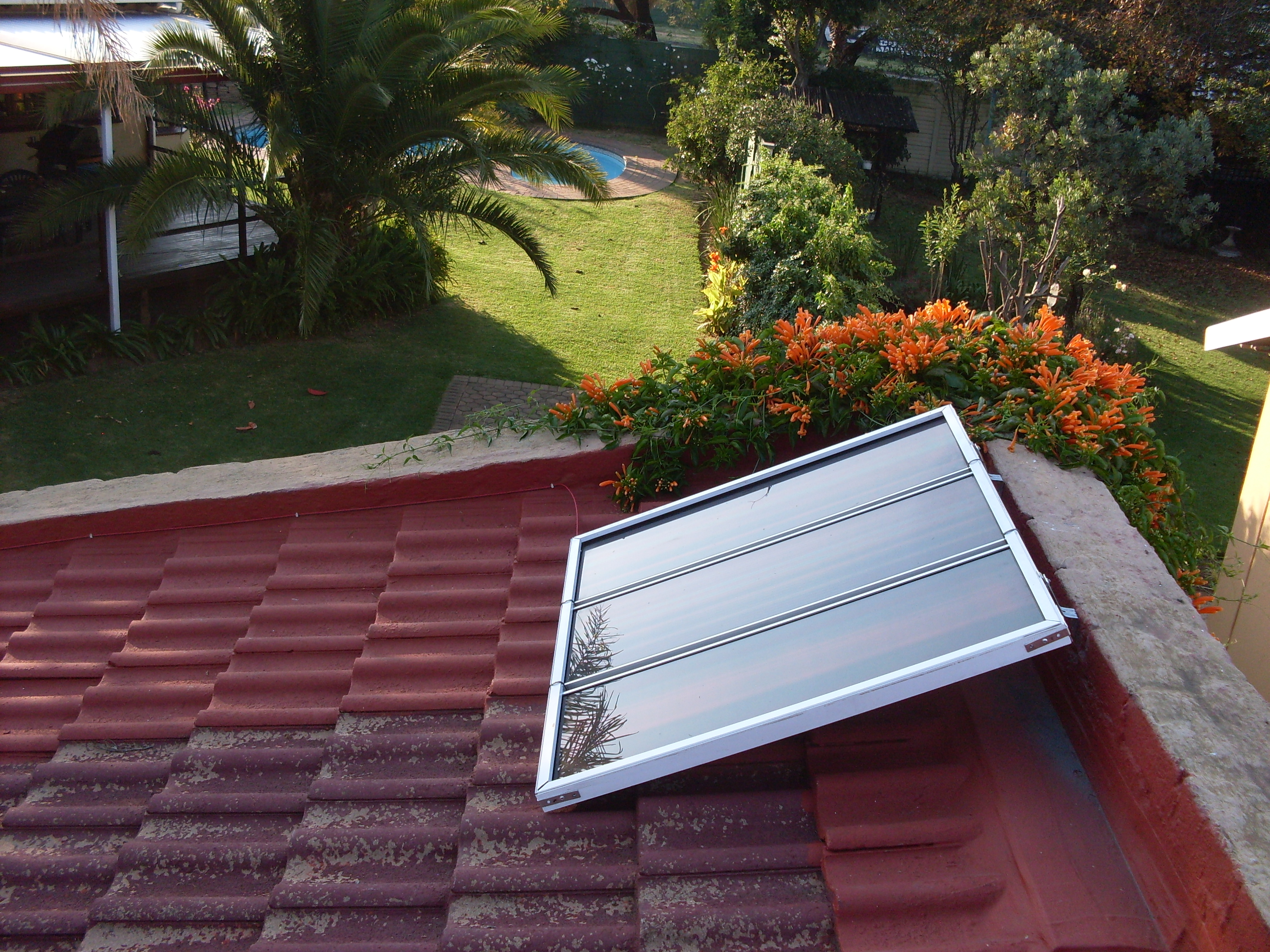 Picture of Mounting Multiple Solar Panels Using Old Window Blind Rails and Hardware