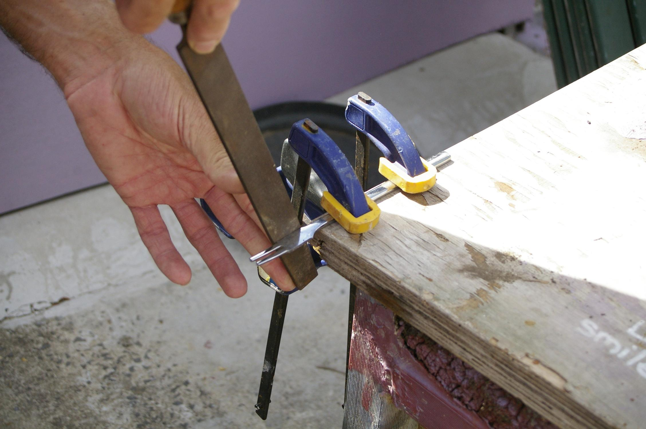 Picture of Filing the Punches to Shape