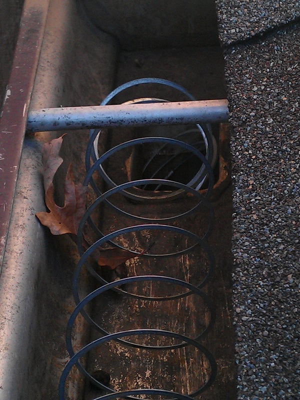 Prevent Gutter Clogging With Slinky;  No Expensive Gutter Guards!