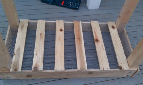 Attach Your Support Boards to the Bottom of the Planter.