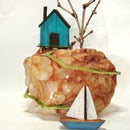 Tiny Wooden House on a Rock