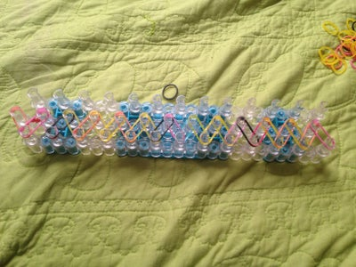 Step 4: Put the Rubber Bands on the Loom Diagonally.