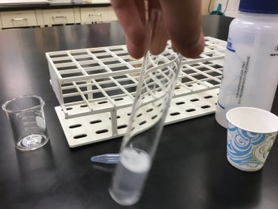 Pouring the Contents Into the Test Tube