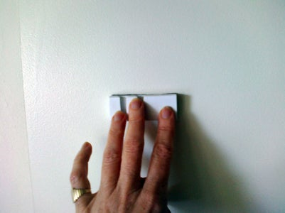 Firmly Press Pencil Holder Onto the Wall