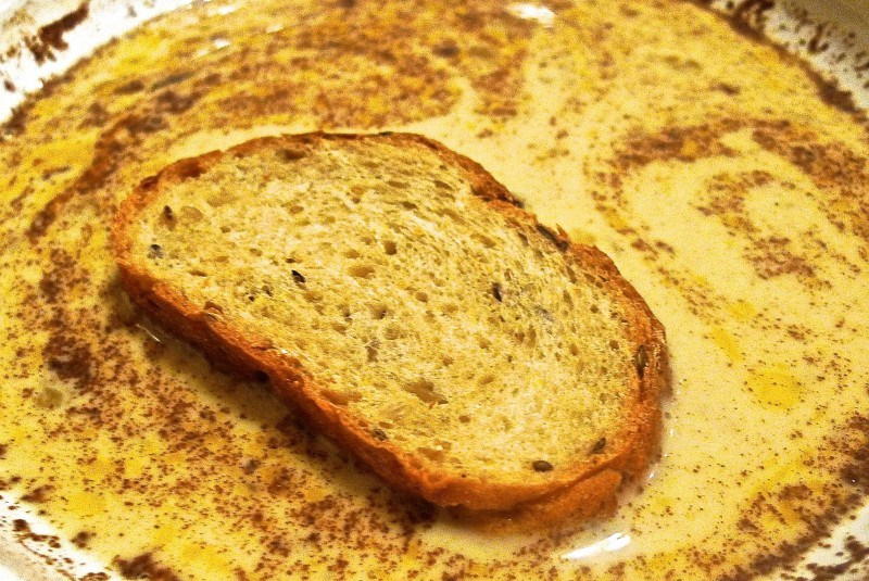 Picture of Dip Each Slice of Thick French Bread Into the Egg Mixture.