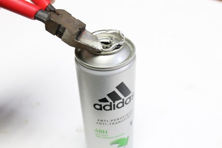 Removing the Metal Seal in the Top of the Can