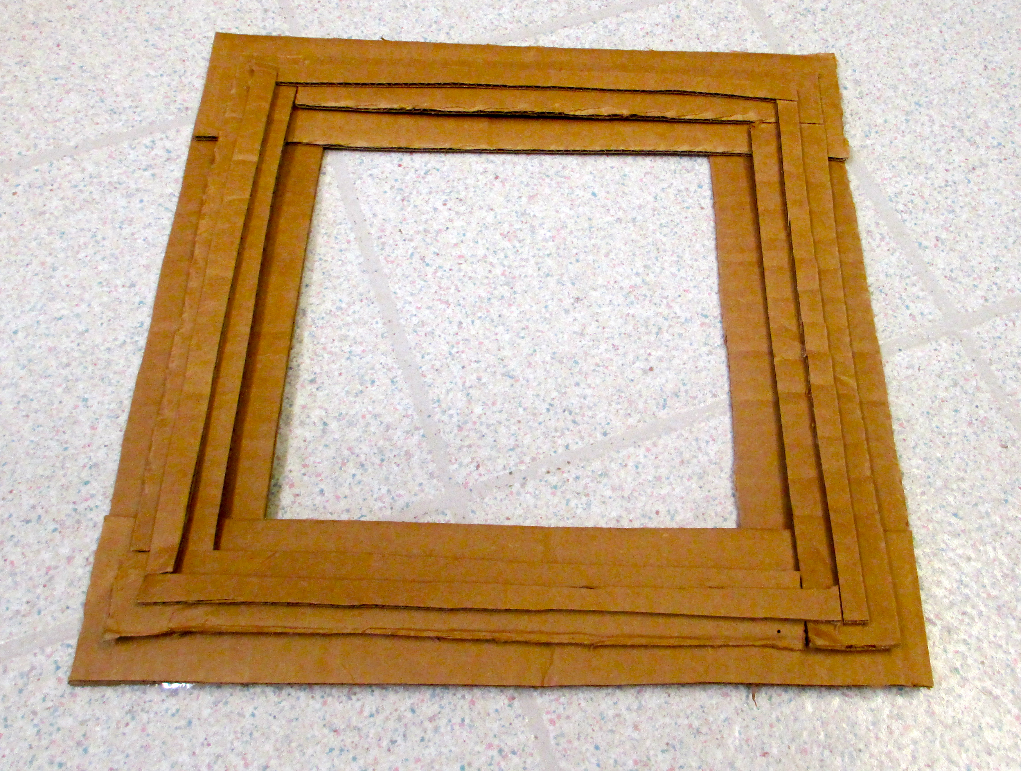 Picture of Use Double-sided Tape to Layer New Flaps Atop Frame.
