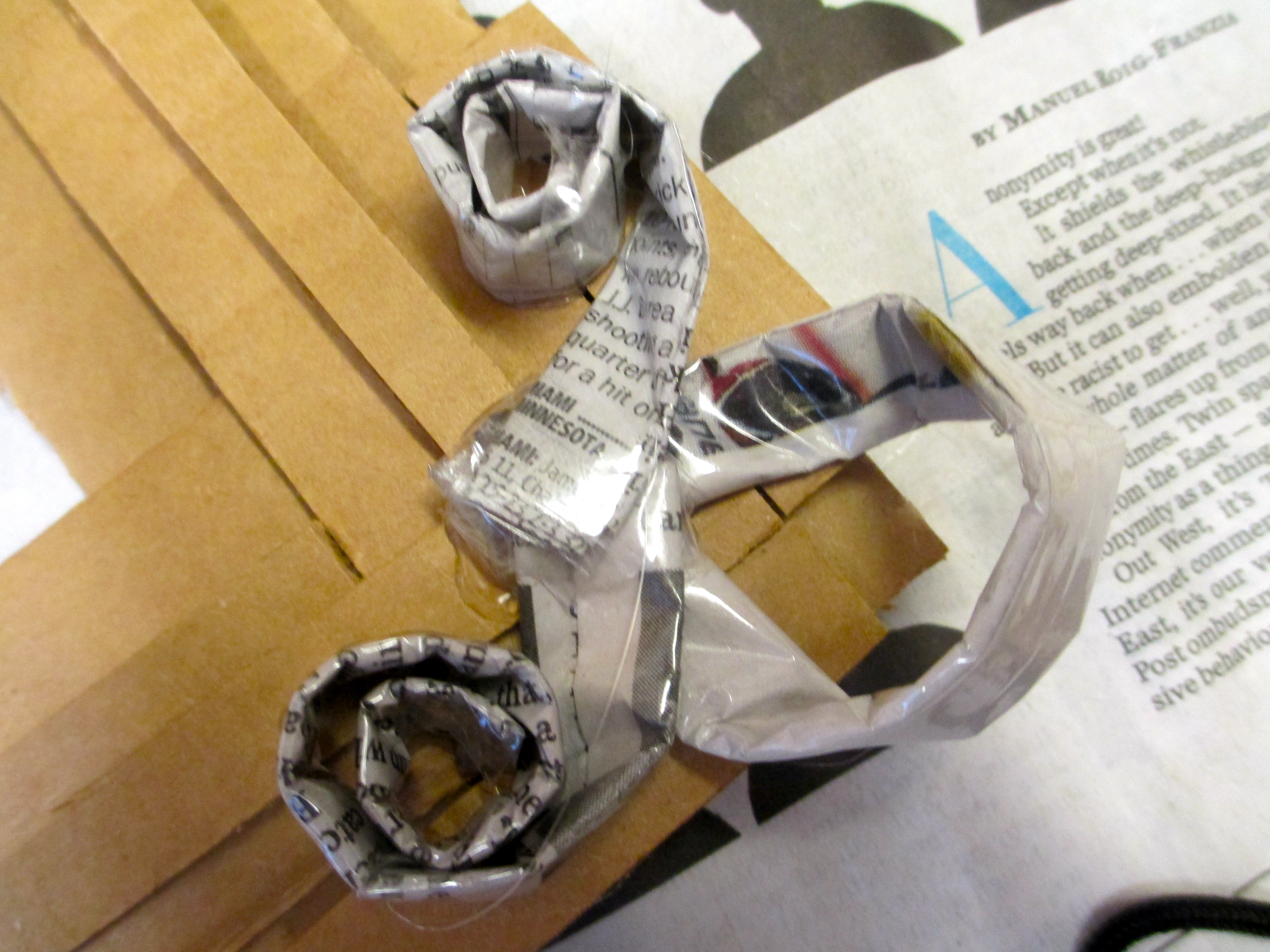 Picture of Adhere 2 Twirly Strips and 1 Flat Strip to Each Corner.