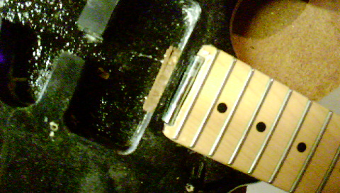 Picture of Mark and Screw the Hinge Into the Guitar Body