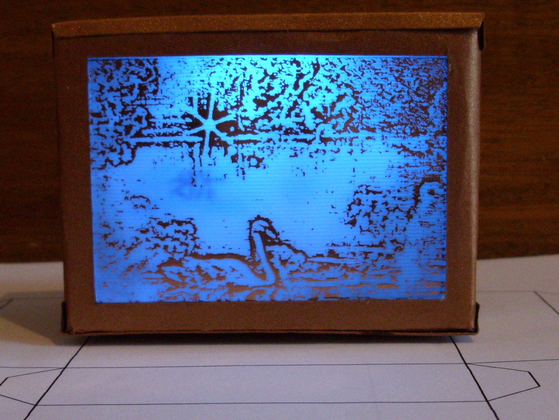 Picture of SWAN ILLUMINATED BY LED RGB ON COPPER PLATE CYGNE ILLUMINE EN RGB