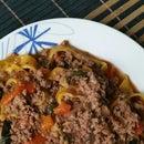 Homemade pumpkin pasta with ground beef sauce