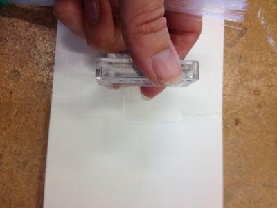 Insert Ends of Fiber Optics Lights Into Holes of Pocket Cutter