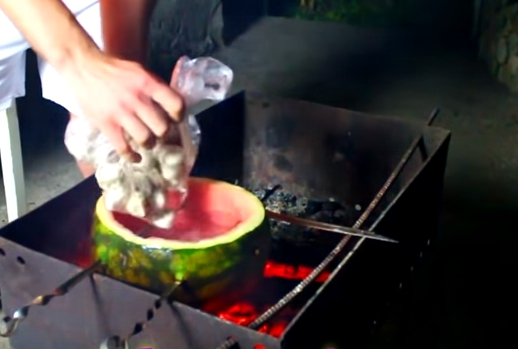 Picture of Cut Off the Top of a Watermelon, Remove Flesh, and Put Frozen Ravioli Inside the Watermelon.