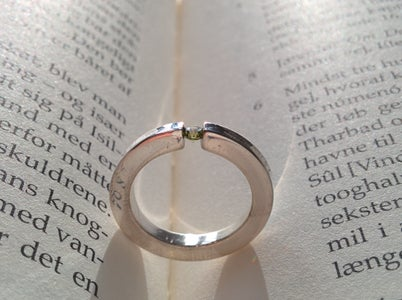 Simple Silver Ring With Tension Set Gemstone
