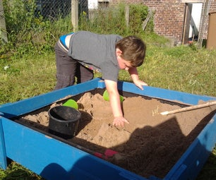 Raised Sand Box With Lid Made From Treated Fence Boards.