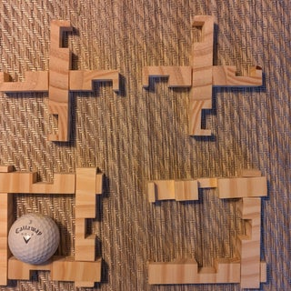 Caged Golf Ball Puzzle