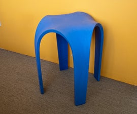 Bent Concrete Side Table from a Rubber Mold.