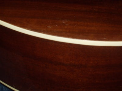 How to Fix the Backing of an Acoustic Guitar
