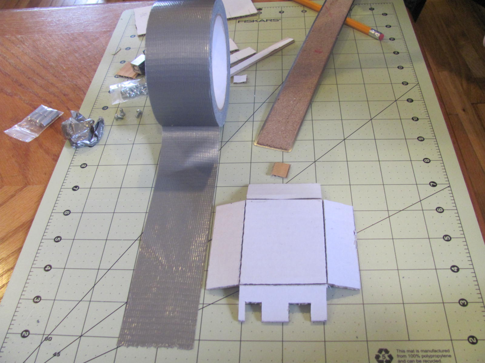 Picture of Put Three Strips of Duct Tape Down and Cut.
