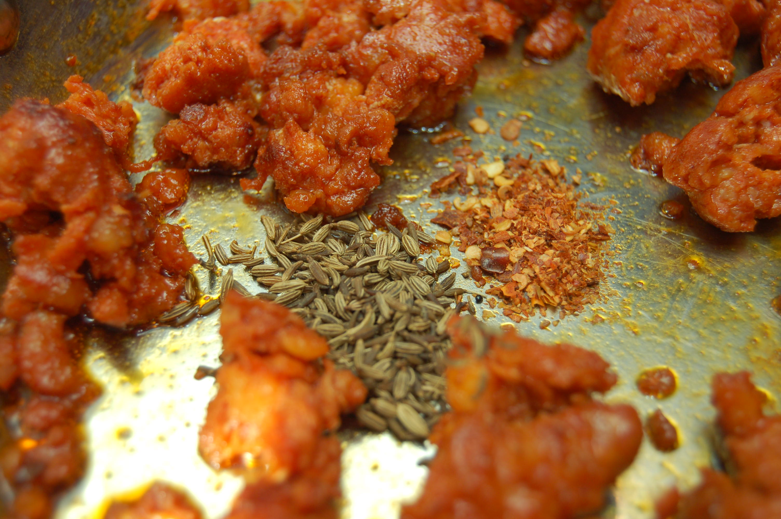 Picture of Add Spices and Tomatoes