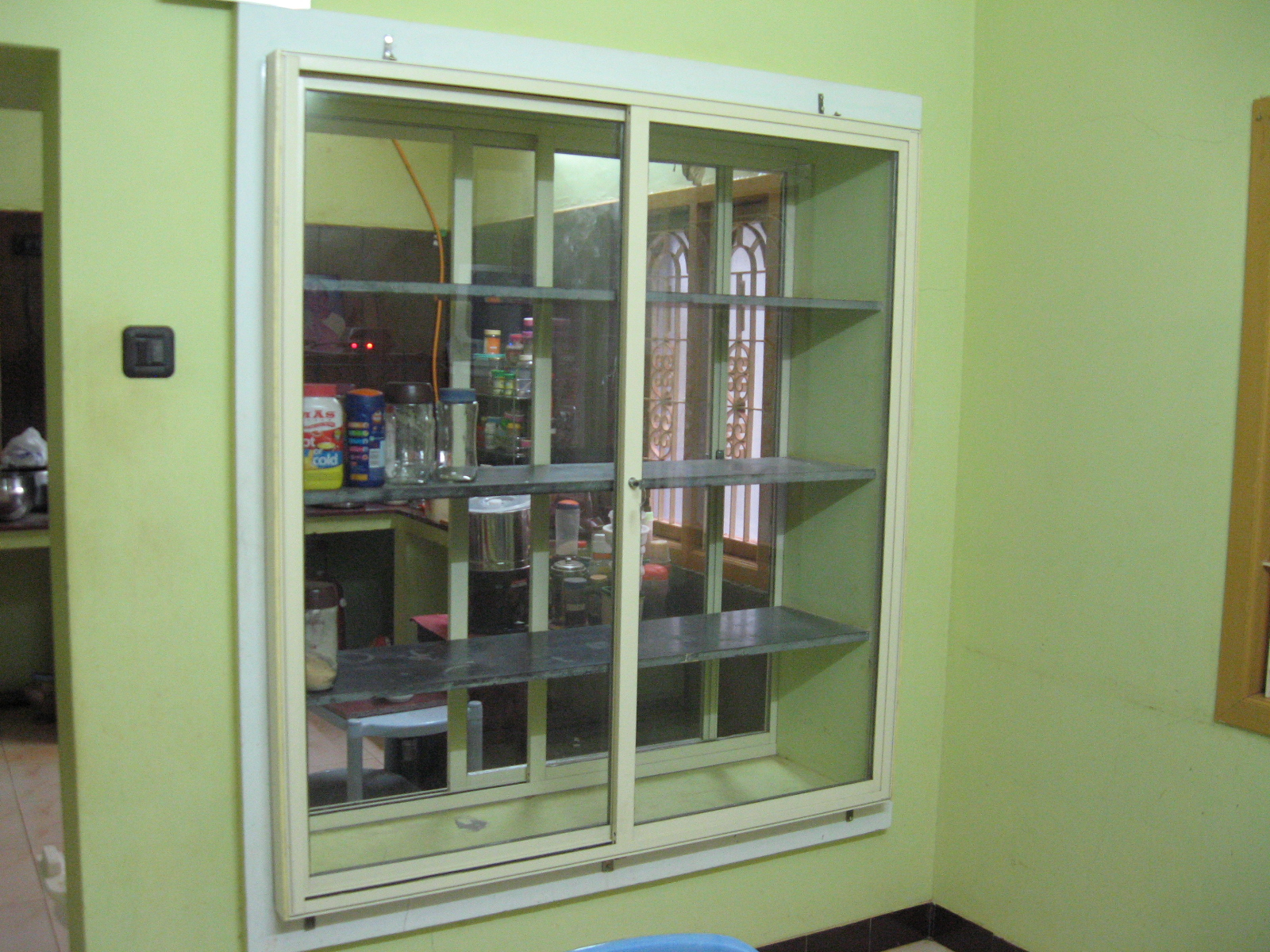 Picture of Home Improvement : Providing Sliding Doors for Kitchen Cupboard
