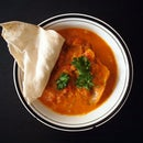Fish with tomato-coconut curry