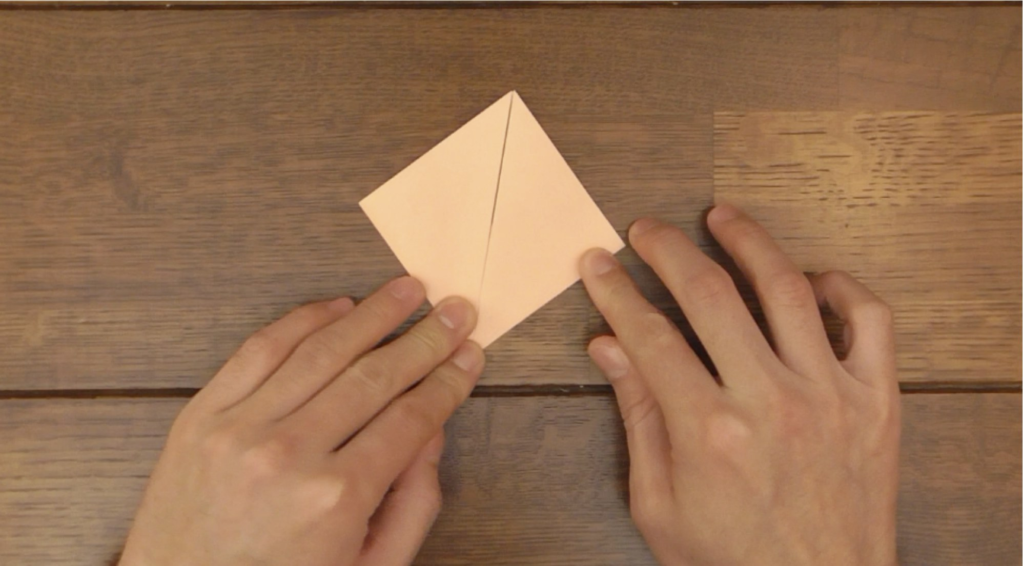 Picture of Fold Both Points Down to the Bottom Point