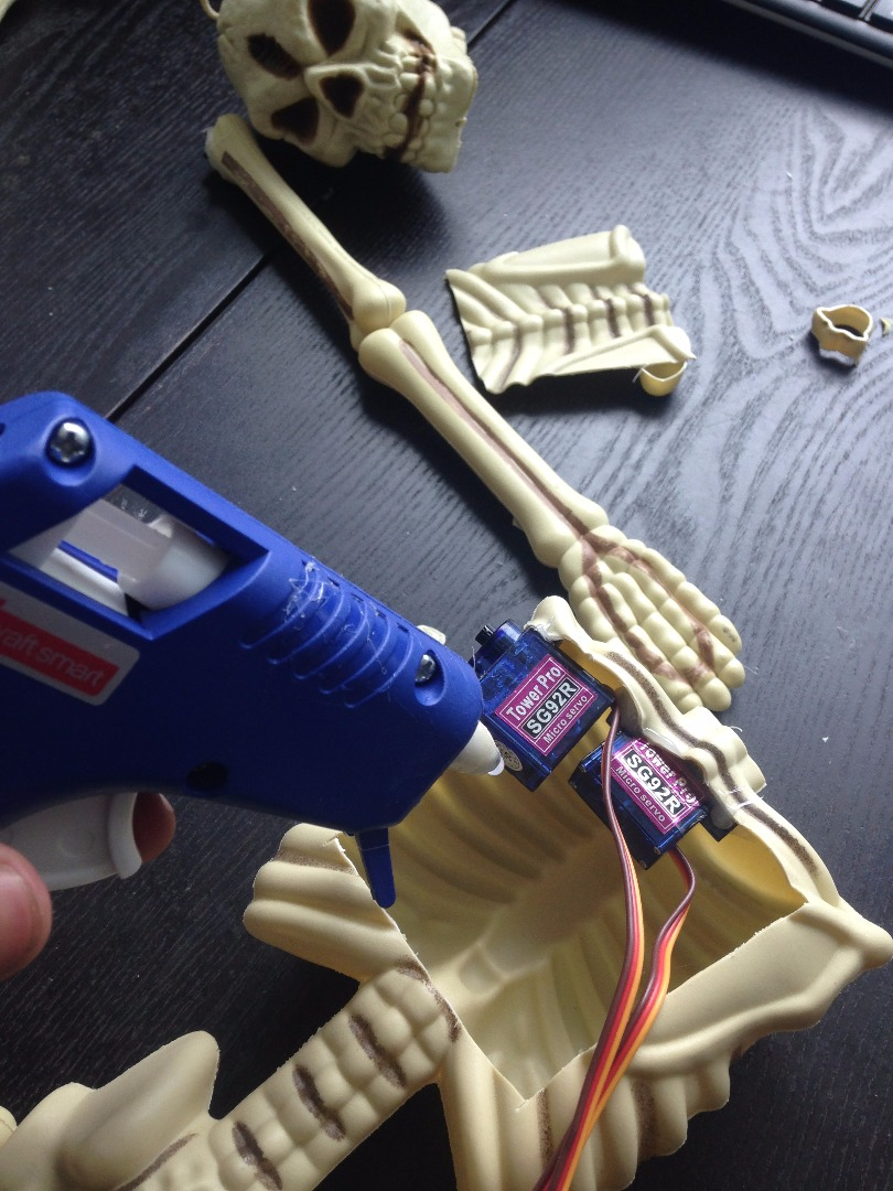 Picture of Hotglue the Servos to the Skeleton