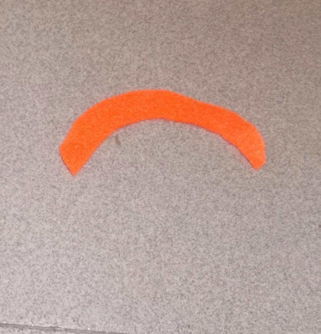 Picture of Cut the Orange Felt Headband and Glue It Onto the Head.