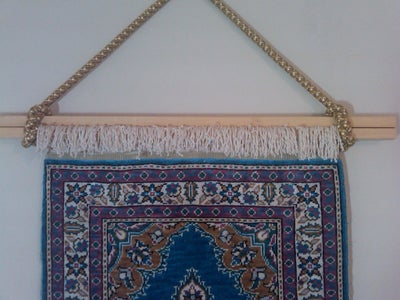 Hanging Fringed Rug on Wall