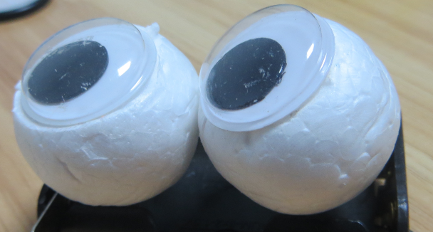Picture of Use Knife to Slice EPS Foam Ball to Make a Flat Surface for Sticking the Eyes