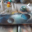How to spray paint art planets on a used skateboard or longboard