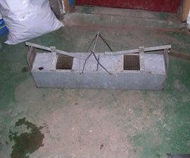 Sheet metal rat trap, modern version of traditional slate trap.