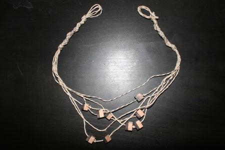 Start Knotting the Other Side of Your Necklace/Bracelet