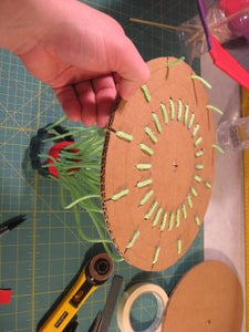 Attach Rope Deflector Rings to Cardboard Disc