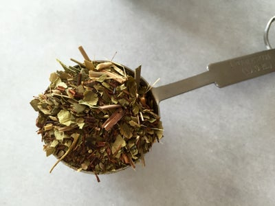 Measure Loose Leaves and Pour Into Strainer