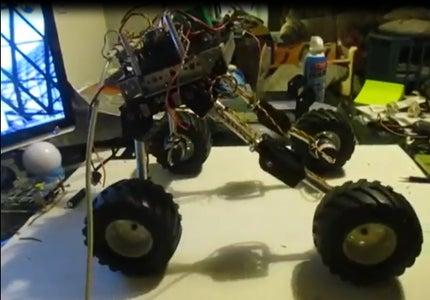 A Rover Robot With a Quadruped Robot's Leg.