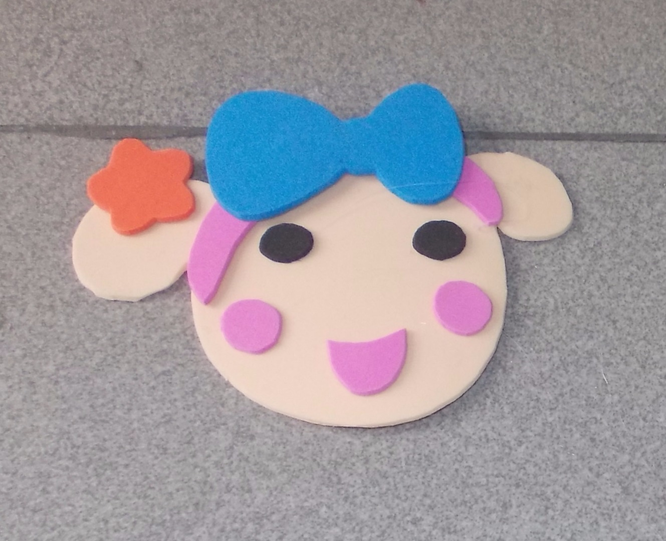 Picture of Cut the Bow, Eyes, Mouth, Cheeks and Glue Them Onto the Head.